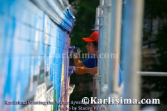 karlisima_on_scaffold_painting_the_mama_ayeshas_restaurant_presidential_mural