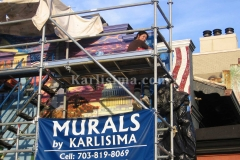 Karlisima_on_top_of_the_scaffold_at_the_mama_ayesha's_restaurant_presidential_mural