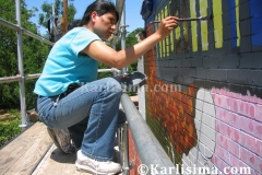 karlisima_painting_the_mama_ayesha's_restaurant_presidential_mural