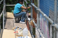 karlisima_painting_the_mama_ayeshas_restaurant_presidential_mural